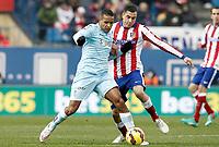 Atletico de Madrid's Jose Maria Gimenez (r) and Granada's Youssef El Arabi during La Liga match.January 18,2015. (ALTERPHOTOS/Acero)