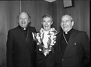 """Fr Niall O'Brien Returns from Captivity.1984..14.07.1984..07.14.1984..On 6 May 1983,Fr Niall O'Brien was arrested along with two other priests, Fr. Brian Gore, an Australian, Fr. Vicente Dangan, a Filipino and six lay workers - the so-called """"Negros Nine"""", for the murders of Mayor Pablo Sola of Kabankalan and four companions. The priests where held under house arrest for eight months but """"escaped"""" to prison in Bacolod City, the provincial capital, where they felt they would be safer.The case received widespread publicity in Ireland and Australia, the home of one of the co-accused priests, Fr. Brian Gore. When Ronald Reagan visited Ireland in 1984, he was asked on Irish TV how he could help the missionary priest's situation. A phone call the next day from the Reagan administration to Ferdinand Marcos resulted in Marcos offering a pardon to Fr. O'Brien and his co-accused..(Ref Wikipedia)...Bishop Eamon Casey and Cardinal O'Fiach share a joke with Fr Niall in the VIP lounge at Dublin Airport."""