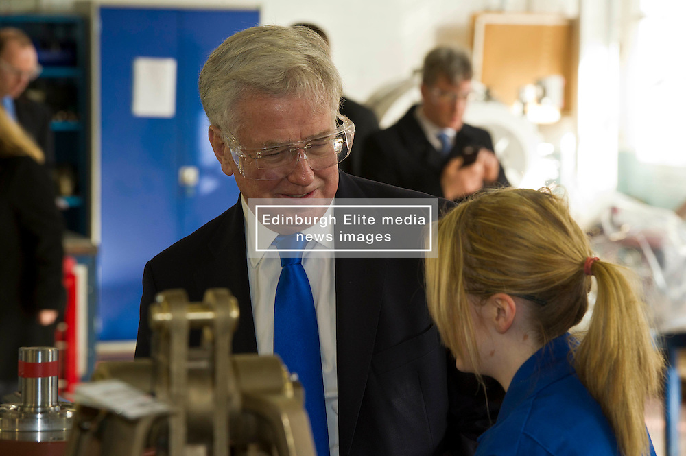 Pictured: Sir Michael Fallon meet apprentice Abbie Cairns during his tour of MacTaggart Scott.<br /> Today Defence Secretary Sir Michael Fallon visited Midlothian engineering firm MacTaggart Scott which designs, builds and installs lightweight, low-noise hydraulic systems used by the British, US, French, Canadian, Australian and South Korean navies.<br /> Ger Harley   EEm 2 February 2017