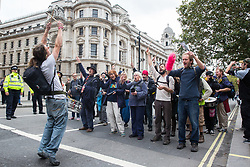 London, UK. 8 October, 2019. Climate activists from Extinction Rebellion perform with the XR Samba Band in Whitehall on the second day of International Rebellion protests to demand a government declaration of a climate and ecological emergency, a commitment to halting biodiversity loss and net zero carbon emissions by 2025 and for the government to create and be led by the decisions of a Citizens' Assembly on climate and ecological justice.
