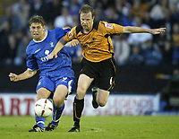 Fotball<br /> Foto: SBI/Digitalsport<br /> NORWAY ONLY<br /> <br /> <br /> Rochdale United v Wolverhampton Wanderers<br /> Coca-Cola cup Round 1<br /> 23/08/2004.<br /> <br /> Rochdale's Grant Holt and Wolves Jody Craddock battle for possesion