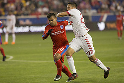 March 1, 2018 - Harrison, New Jersey, United States - German Mejia (29) of CD Olimpia of Honduras & Sean Davis (27) of New York Red Bulls fights for ball during 2018 CONCACAF Champions League round of 16 game at Red Bull arena, Red Bulls won 2 - 0  (Credit Image: © Lev Radin/Pacific Press via ZUMA Wire)