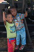 Kids on military gun<br /> Mabaruma<br /> GUYANA<br /> South America