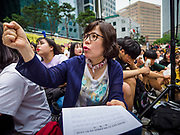 "SEOUL, SOUTH KOREA: A South Korean woman chants against the Japanese refusal to apologize for using Korean women as sex slaves during World War II. The Wednesday protests have been taking place since January 1992. Protesters want the Japanese government to apologize for the forced sexual enslavement of up to 400,000 Asian women during World War II. The women, euphemistically called ""Comfort Women"" were drawn from territories Japan conquered during the war and many came from Korea, which was a Japanese colony in the years before and during the war. The ""comfort women"" issue is still a source of anger of many people in northeast Asian areas like South Korea, Manchuria and some parts of China.         PHOTO BY JACK KURTZ   <br /> Wednesday Demonstration demanding Japan to redress the Comfort Women problems"