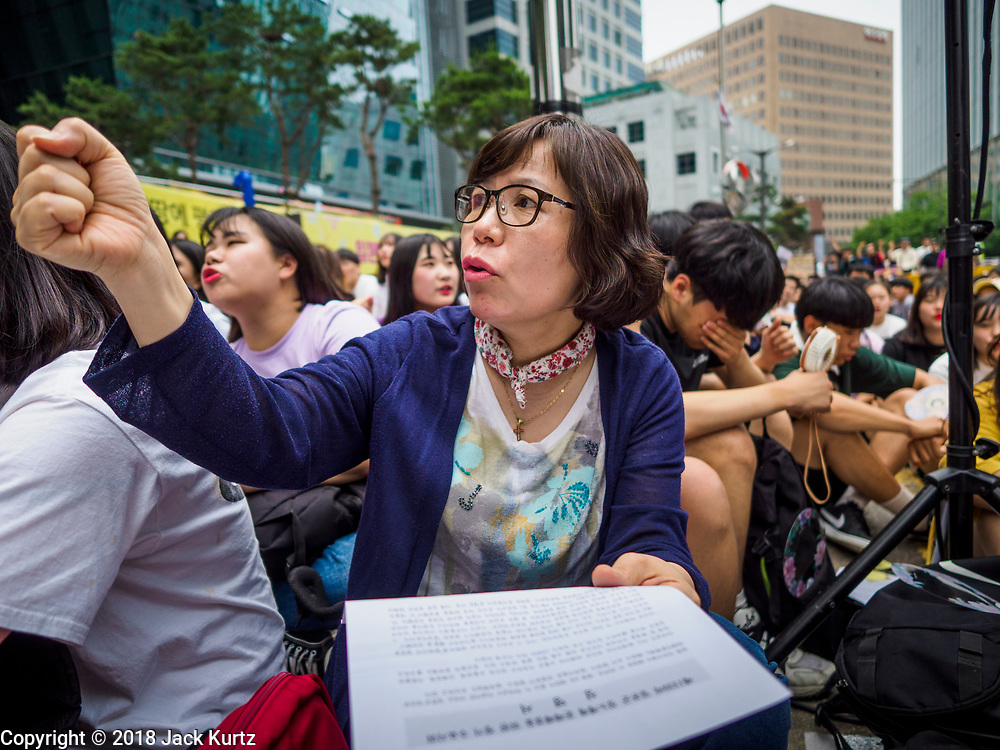 """SEOUL, SOUTH KOREA: A South Korean woman chants against the Japanese refusal to apologize for using Korean women as sex slaves during World War II. The Wednesday protests have been taking place since January 1992. Protesters want the Japanese government to apologize for the forced sexual enslavement of up to 400,000 Asian women during World War II. The women, euphemistically called """"Comfort Women"""" were drawn from territories Japan conquered during the war and many came from Korea, which was a Japanese colony in the years before and during the war. The """"comfort women"""" issue is still a source of anger of many people in northeast Asian areas like South Korea, Manchuria and some parts of China.         PHOTO BY JACK KURTZ   <br /> Wednesday Demonstration demanding Japan to redress the Comfort Women problems"""
