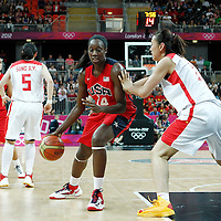 05 August 2012: USA Tina Charles posts up China Song Gao during 114-66 Team USA victory over Team China, during the women's basketball preliminary, at the Basketball Arena, in London, Great Britain.
