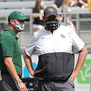 ORLANDO, FL - OCTOBER 24:  Head coach Willie Fritz of the Tulane Green Wave and head coach Josh Heupel of the Central Florida Knights talk at Bounce House-FBC Mortgage Field on October 24, 2020 in Orlando, Florida. (Photo by Alex Menendez/Getty Images) *** Local Caption *** Willie Fritz; Josh Heupe