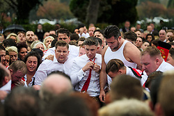 © Licensed to London News Pictures. 26/10/2017. Epsom, UK. Family members and mourners remove Manchester United clothing and throw it on to the grave at the funeral of Tom 'Tomboy' Doherty the nephew of Big Fat Gypsy Weddings star Paddy Doherty, at Epsom Cemetery in Epsom, Surrey. Tom Doherty was 17 when he was killed in a car crash in South Nutfield in Surrey on October 9. He had passed his driving test just days earlier. Photo credit: Ben Cawthra/LNP