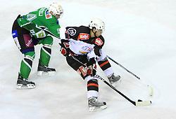 Andrej Tavzelj vs Mitja Robar at 39th Round of EBEL League ice hockey match between HDD Tilia Olimpija and Acroni Jesenice, on December 30, 2008, in Arena Tivoli, Ljubljana, Slovenia. Tilia Olimpija won 4:3. (Photo by Vid Ponikvar / SportIda).