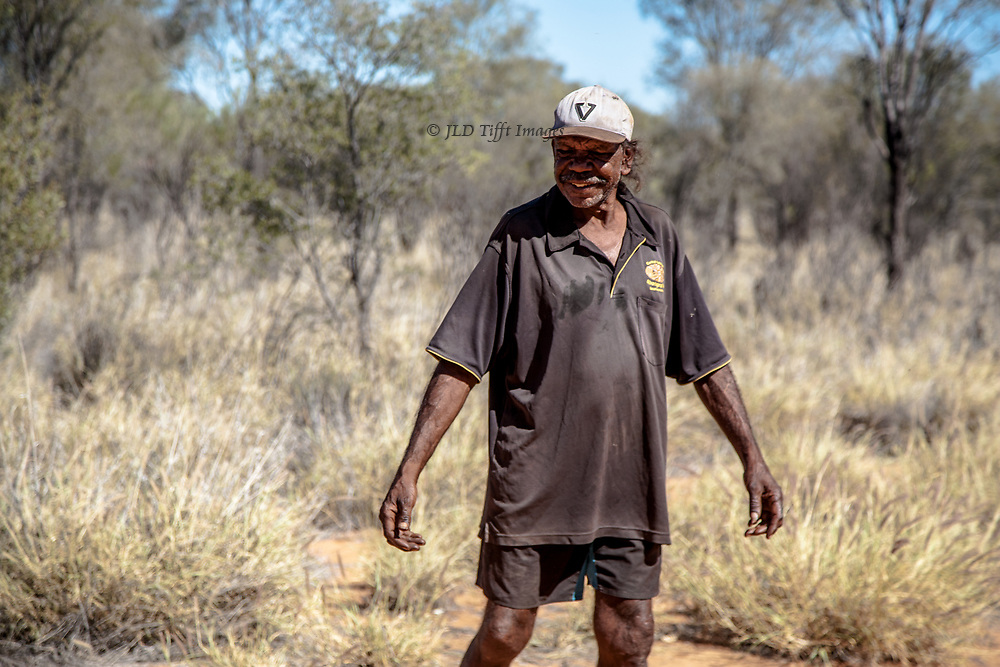 Smiling shyly for the camera.  Aboriginal people do not usually care to have their photos made.  This man is accustomed to tourists and likes to teach them how to throw a boomerang.