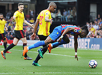 Football - 2017 / 2018 Premier League - Watford vs. Crystal Palace<br /> <br /> Wilfried Zaha of Palace dives in the penalty box looking for a penalty kick after a challenge from Christian Kabasele, at Vicarage Road.<br /> <br /> COLORSPORT/ANDREW COWIE