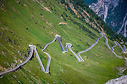 Cars on The Stelvio Pass, Passo dello Stelvio, Stilfser Joch, on the route towards Bormio in the Eastern Alps in Northern Italy