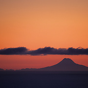 Redoubt Volcano rises above the shores of Homer, Alaska during dawn.