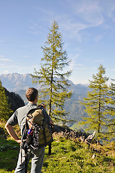 Hiker looking at mountains, Salzburger Land, Austria