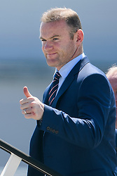 © Licensed to London News Pictures. 06/06/2016. Luton, UK. England captain WAYNE ROONEY joins other members of England national football squad as they board a plane at Luton airport in Bedfordshire, England, to head for their training camp in France, ahead of the start of the UEFA Euro 2016 championships.  Photo credit: Ben Cawthra/LNP