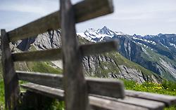 THEMENBILD - Nationalpark Hohe Tauern ist der groesste Nationalpark Oesterreichs und umfasst Teile des zentralalpinen Hauptkamms der Ostalpen. Das Bild wurde am 04. Julii 2014 aufgenommen. im Bild Grossglockner (3798 m) und Glocknerwand hinter einer Bank // THEMES PICTURE - High Tauern National Park, which is the largest National Park in Austria. The High Tauern are a mountain range on the main chain of the Central Eastern Alps. The image was taken on july, 04th, 2014. Picture shows Grossglockner, the highest mountain of austria behind a bench, AUT, EXPA Pictures © 2014, PhotoCredit: EXPA/ Michael Gruber