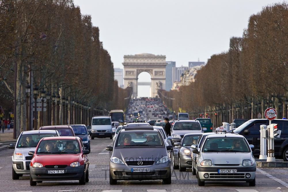 Traffic stops at pedestrian crossing on Champs-Élysées, Central Paris, France