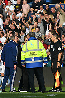 Football - 2019 / 2020 Sky Bet (EFL) Championship - Swansea City vs. Reading<br /> <br /> Cardiff City manager Neil Warnock  speaks to officials on the pitch after the game , at the Liberty Stadium.<br /> <br /> COLORSPORT/WINSTON BYNORTH