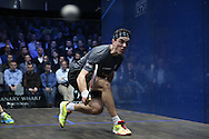 Joe Lee of England (in the grey shirt) hitting a shot vs Mathieu Castagnet of France (wearing the black shirt). Canary Wharf Squash Classic 2016 , day two at the East Wintergarden in Canary Wharf , London on Tuesday 8th March 2016.<br /> pic by John Patrick Fletcher, Andrew Orchard sports photography.