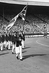 The Great Britain team march around Wembley Stadium during the parade of competitors. Carrying the Union Flag is British fencer John Emrys Lloyd.