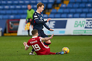 Harry Paton of Ross County is brought down by Lewis Ferguson of Abrerdeen during the Scottish Premiership match between Ross County FC and Aberdeen FC at the Global Energy Stadium, Dingwall, Scotland on 16 January 2021.