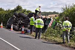 © Licensed to London News Pictures.  17/07/2012. OXFORD, UK. A 45-tonne crane lies in a ditch in Woodeaton near Oxford after an accident last night. Recovery efforts are underway and are expected to take most of the day. The driver was uninjured. Photo credit: Cliff Hide/LNP