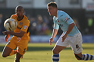 Chris Zebroski of Newport and Danny Coles of Exeter (r) . Skybet football league two match, Newport county v Exeter city at Rodney Parade in Newport, South Wales on Sunday 16th March 2014.<br /> pic by Mark Hawkins, Andrew Orchard sports photography.