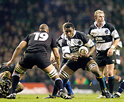 Twickenham, Surrey, 4th December 2004, The Gartmore Challenge Rugby Cup,  Barbarians vs New Zealand, RFU Stadium, England,<br /> Baabaa Radike Samo, looks for a way around all Black Mose Tuiali'i<br /> <br /> [Mandatory Credit; Peter Spurrier/Intersport Images]
