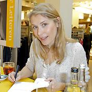 NLD/Amsterdam/20120310 - Feest der Letteren 2012 , Elle van Rijn signeert boek