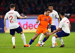 Memphis Depay of Netherlands takes on Kieran Trippier, Alex Oxlade-Chamberlain and Kyle Walker of England - Mandatory by-line: Robbie Stephenson/JMP - 23/03/2018 - FOOTBALL - Amsterdam ArenA - Amsterdam,  - Netherlands v England - International Friendly