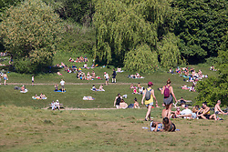 © Licensed to London News Pictures. 20/05/2020. London, UK. Warm sunny weather in Hampstead Heath, north London today as people get out of the house from coronavirus lockdown to relax, sunbathe or walk in the park.  Photo credit: Marcin Nowak/LNP