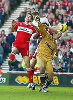 7/11/2004 - FA Barclayship Premiership - Middlesbrough v Bolton Wanderers - The Riverside Stadium<br />Middlesbrough's goalkeeper Mark Schwarzer is elbowed in the head by team mate Gareth Southgate as he and Chris Riggott (left) both try to head the ball from a corner.<br />Photo:Jed Leicester/Back Page Images