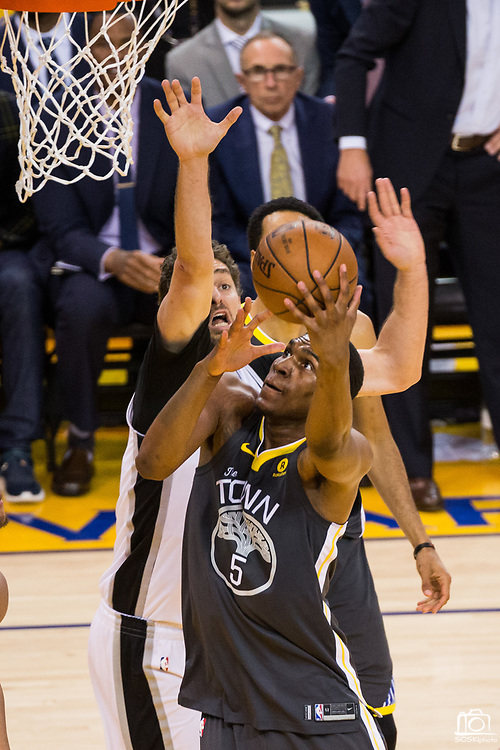 Golden State Warriors forward Kevon Looney (5) takes the ball to the basket against the San Antonio Spurs during Game 2 of the Western Conference Quarterfinals at Oracle Arena in Oakland, Calif., on April 16, 2018. (Stan Olszewski/Special to S.F. Examiner)