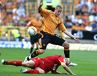 Photo: Paul Greenwood. <br />Wolverhampton Wanderers v Watford. Coca Cola Championship. 11/08/2007. <br />Watford's Gavin Mahon takes the ball from Wolves Michale Kightly with a sliding tackle