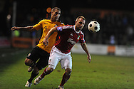 Wrexham's Neil Ashton ® holds off Newport's Ryan Charles. Blue Square Bet Premier division, Newport County FC v Wrexham at Rodney Parade in Newport, South Wales on Friday 4th Jan 2013. pic by Andrew Orchard, Andrew Orchard sports photography,