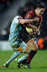 Saracens Inside Centre (#12) Brad Barritt is tackled during the second half of the match - Photo mandatory by-line: Rogan Thomson/JMP - Tel: Mobile: 07966 386802 30/12/2012 - SPORT - RUGBY - stadiummk - Milton Keynes. Saracens v Northampton Saints - Aviva Premiership.