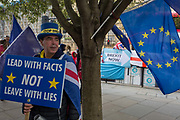 On the day that the EU in Brussels agreed in principle to extend Brexit until 31st January 2020 aka Flextension and not 31st October 2019, Remain personality Steve Bray looks towards a Brexit protest outside parliament, on 28th October 2019, in Westminster, London, England.