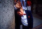 25 JULY 2002 - HAVANA, HAVANA, CUBA: A boy in a tuxedo in front of the government wedding office in Havana, Cuba, July 25, 2002..PHOTO BY JACK KURTZ