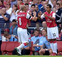 Photo: Daniel Hambury.<br />Arsenal v Aston Villa. The Barclays Premiership. 19/08/2006.<br />Arsenal's Theo Walcott (R) comes on as a second half sub for Fredrik Ljungberg.