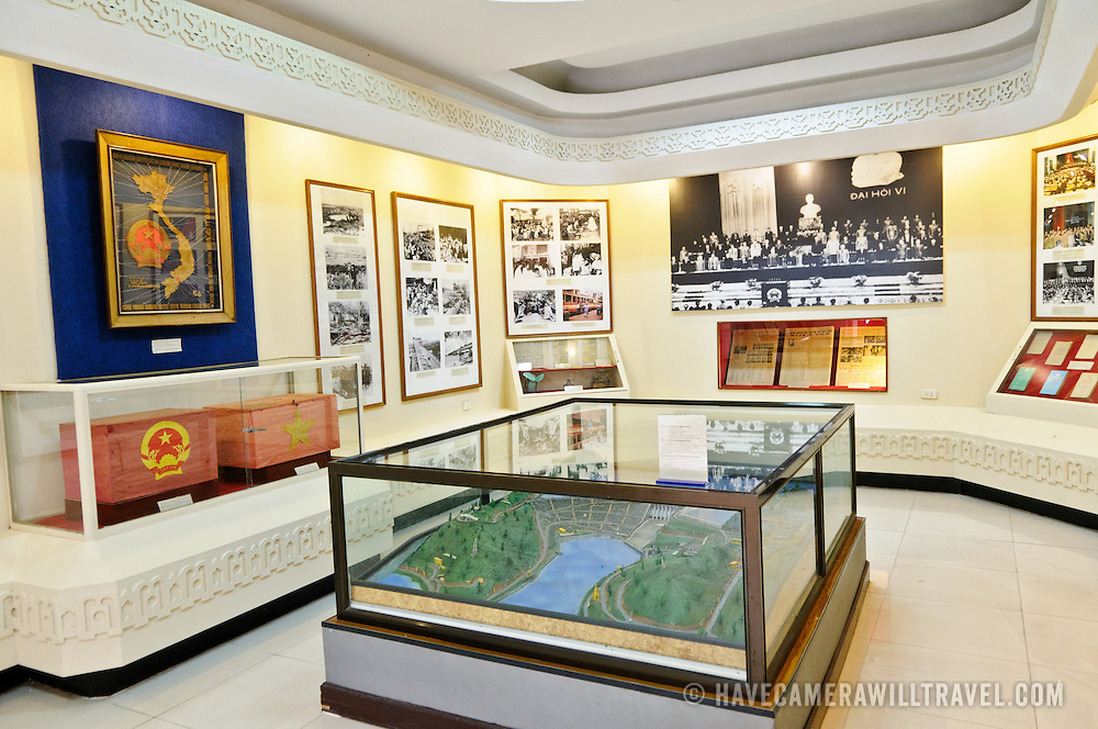 An exhibiit  with landscape model in the foreground in the glass case. The Museum of the Vietnamese Revolution in the Tong Dan area of Hanoi, not far from Hoan Kiem Lake, was established in 1959 and is devoted to the history of the socialist revolutionary movement in Vietnam.
