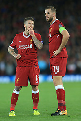 13th September 2017 - UEFA Champions League - Group E - Liverpool v Sevilla - Alberto Moreno of Liverpool(L) whispers to teammate Jordan Henderson - Photo: Simon Stacpoole / Offside.