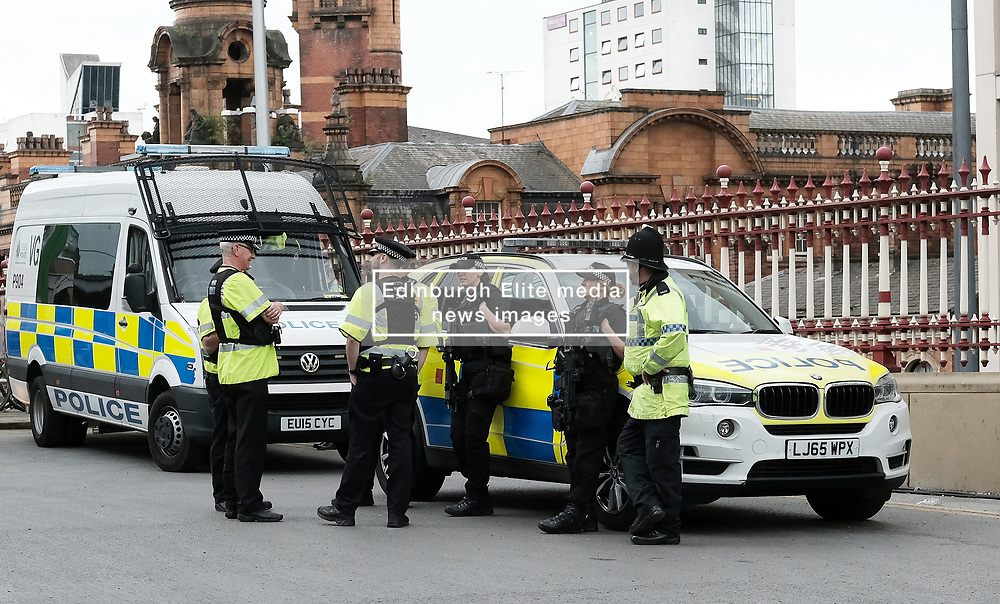 St Ann's Square, Manchester, Sunday 4th June 2017<br /> <br /> Two female armed Police officers chat to colleagues outside Manchester Piccadilly train station this afternoon<br /> <br /> Today is the last day that the flora tribute to those killed in the Manchester  Arena bombing will be on show as it has been decided to remove them after the weekend.<br />  <br /> (c) Alex Todd | Edinburgh Elite media