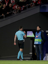 Refere Felix Zwayer reviews the footage on a tv screen at the side of the pitch before disallowing Atletico Madrid's Alvaro Morata's goal using VAR