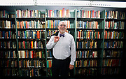 Recently hired Director of the Wisconsin University Press, Dennis Lloyd poses for a portrait in the Wisconsin Memorial Library, Thursday, July 16, 2015.