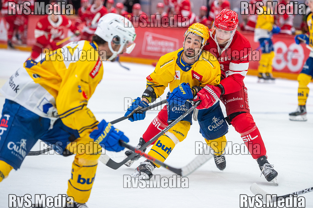 LAUSANNE, SWITZERLAND - SEPTEMBER 24: TopScorer Andres Ambuhl battles for the puck with Martin Gernat #28 of Lausanne HC during the Swiss National League game between Lausanne HC and HC Davos at Vaudoise Arena on September 24, 2021 in Lausanne, Switzerland. (Photo by Monika Majer/RvS.Media)
