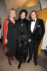 Left to right, LOUISE FENNELL, CHRISTINA ESTRADA JUFFALI and THEO FENNELL at Chaos Point - a fashion show from Viienne Westwood's Gold Label Collection in aid of the NSPCC at The Banqueting House, London SW1 on 18th November 2008.
