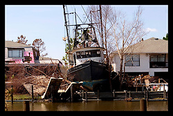 8th Sept, 2005. Hurricane Katrina aftermath. New Orleans. Venetian Isles in East New Orleans, where the tidal surge washed over the land and devastated homes and property. A shrimp boat rests between residential houses.