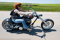 Lora Baccari on the Cycle Source ride during the 78th annual Sturgis Motorcycle Rally. Sturgis, SD. USA. Wednesday August 8, 2018. Photography ©2018 Michael Lichter.
