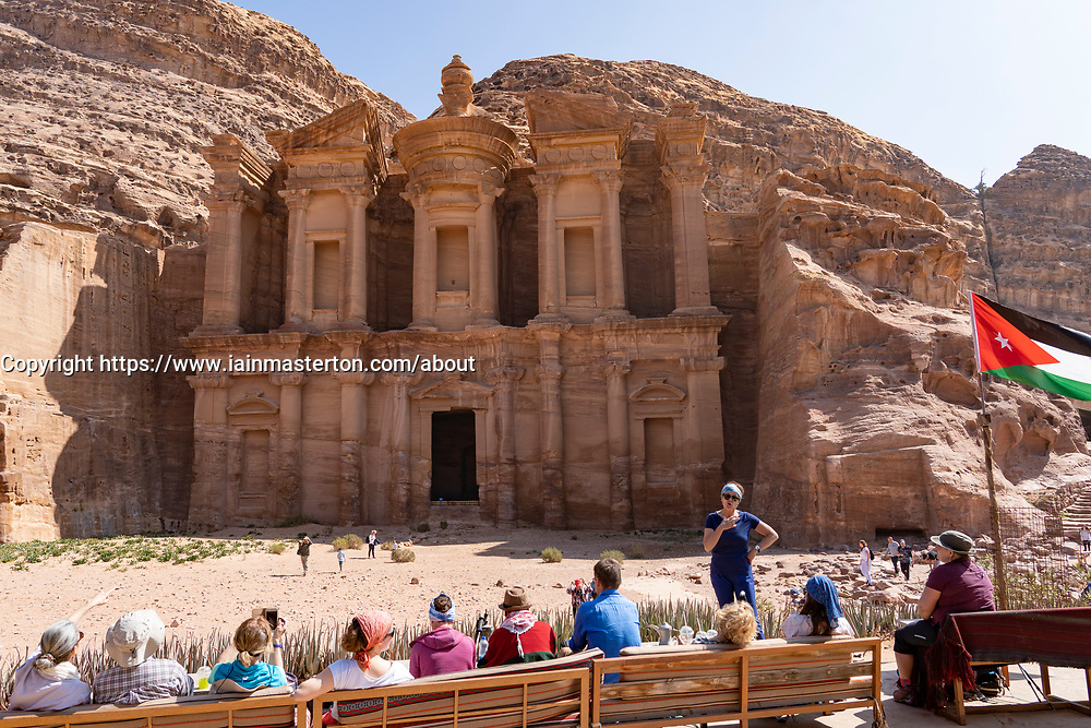 View of Ad-Deir Monastery at Petra with tourists in cafe in Jordan.UNESCO World Heritage Site