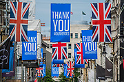 Flags thanking our heroes in New Bond Street - The 'lockdown' continues for the Coronavirus (Covid 19) outbreak in London.